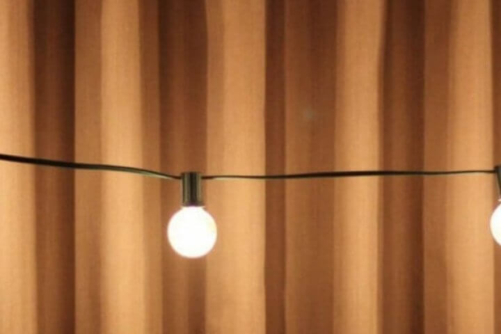 patio lights in front of a curtain
